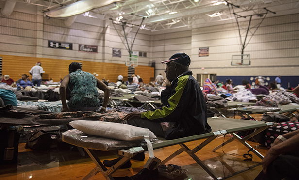 What happens when a hurricane collides with a pandemic